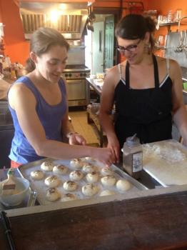 Suzanne and I apply Zaatar to rolls. Don't look for these in the cookbook. They were one of the NOT following the recipe incidents.